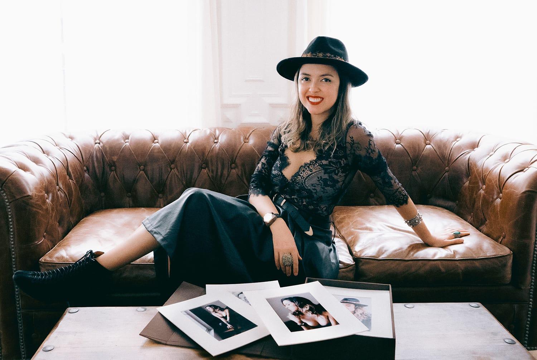 gloria villa top paris boudoir photographer walking thorough the streets on a red coat during her portrait photoshoot