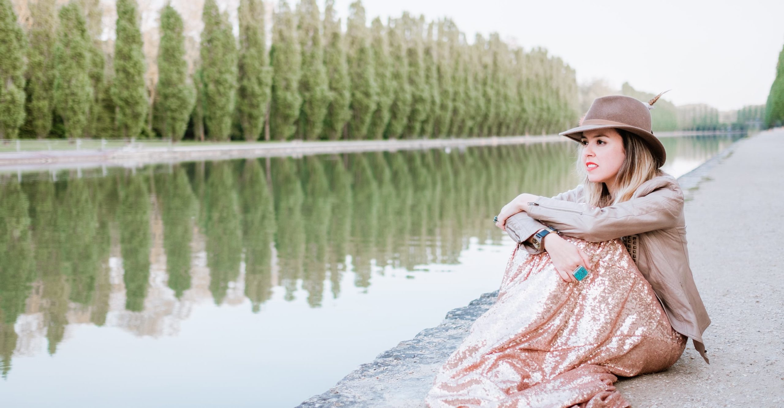 gloria villa paris boudoir photographer sitting on the edge of a lake in france
