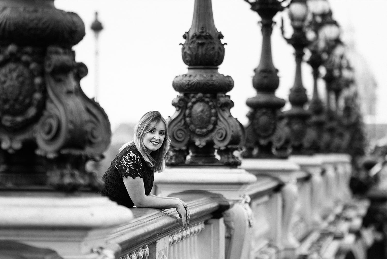 beautiful woman in a bridge during her boudoir photoshoot in Paris